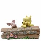 Pooh and Piglet on a Log